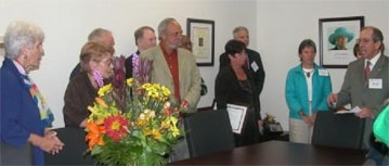 Guests gathered in the Nancy K. Schlossberg Conference Room as Vice President Brodie Remington (right), University Relations, paid tribute to Professor Emerita Schlossberg (left). Photo from the University of Maryland University Relations Office.